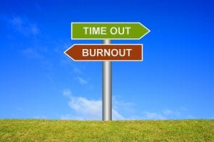 Signpost showing directions Time out or Burnout