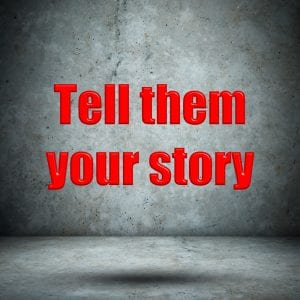 Tell them your story concrete wall