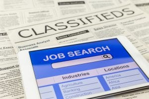 Searching job with tablet and classifieds ads