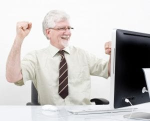 older employee celebrating a success